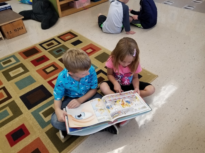 KM Kinders share stories with a friend