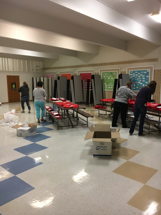 MPCG booster club members getting t shirt orders ready for tomorrow