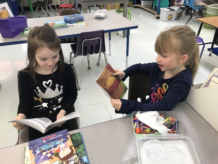 Partner reading in first grade.