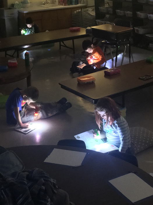 First graders using flashlights during Read to Self time today
