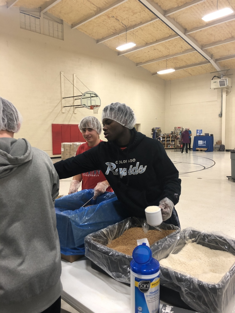 MPCG Boys Basketball packaging food at Feed My Starving Children!