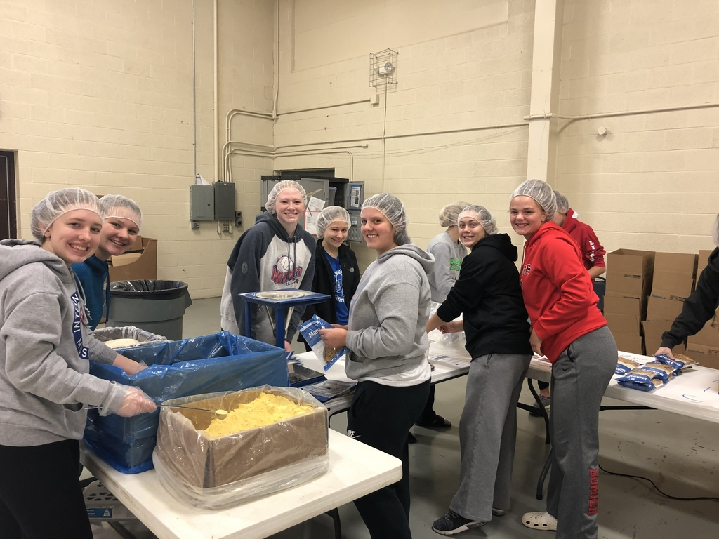 MPCG Girl's basketball packaging food for Feed My Starving Children!