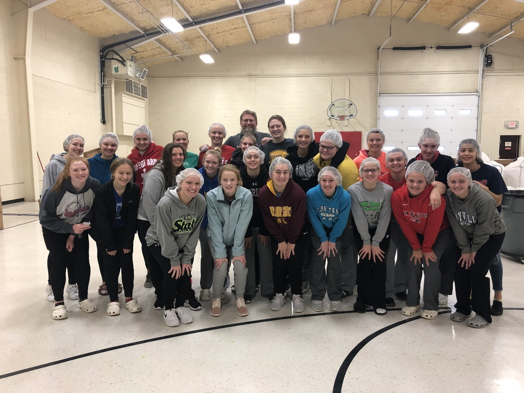 MPCG Girls Basketball packaging food at Feed My Starving Children!