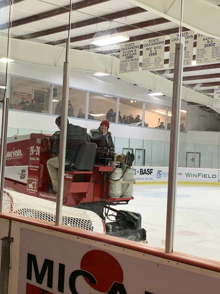 Mrs. Blotsky getting a ride on the Zamboni!