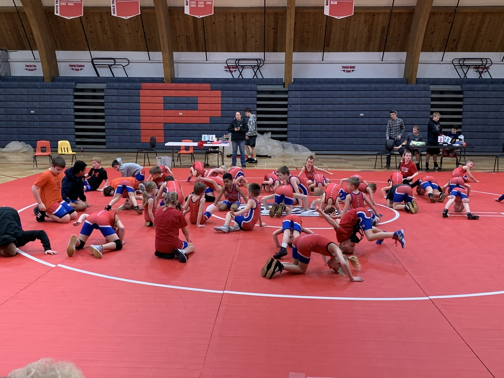 Wrestlers warming up before their matches.