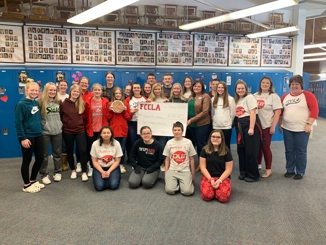 A proud moment for MPCG FCCLA ... $483 to Childrens Miracle Network and director Hillery Mork from caramel apple sales!